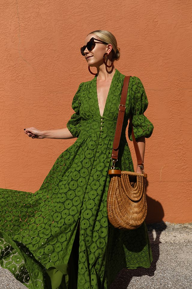 3258d3fc4e8 Blair Eadie wearing a Cult Gaia eyelet dress with a Staud straw bag and  Lele Sadoughi hoop earrings    Sunglasses by Saint Laurent    Click through  for more ...