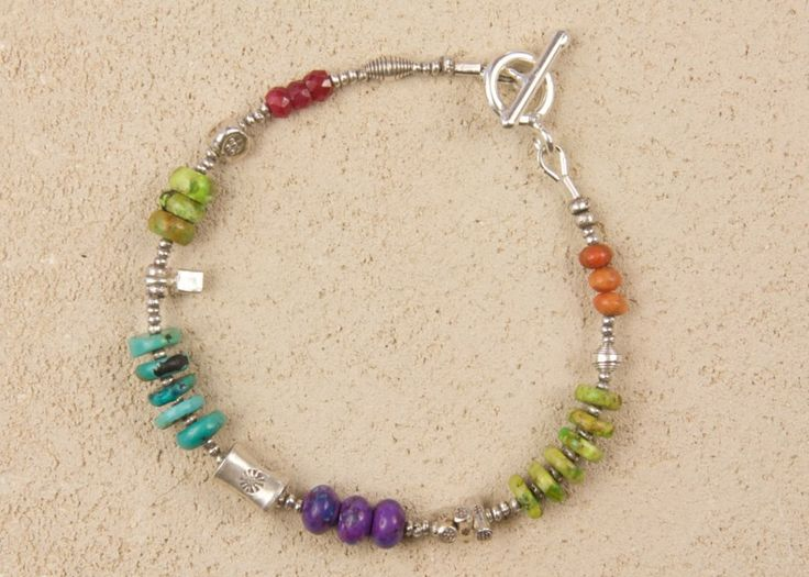 Super chunky carousel has tiny hill tribe silver beads, ruby, coral, green, purple and blue turquoise.  Product in stock Price: $118.00