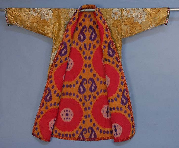 CLOTH of SILVER and GOLD COAT, 19th-EARLY 20th C. Bokhara region with brocade large scale design of flowers and foliage having wheat sheaves outlined in red, colorful silk ikat lining in purple,