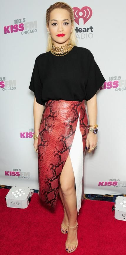 Rita Ora looked equally edgy and polished at 103.5 Kiss FM's Jingle Ball in a Sportmax black top and snakeskin red and white paneled skirt. She finished the look with a layered gold choker and nude Stuart Weitzman sandals.