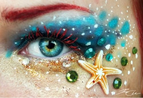 Aquatic themed starfish eye make-up with aqua and green crystals.