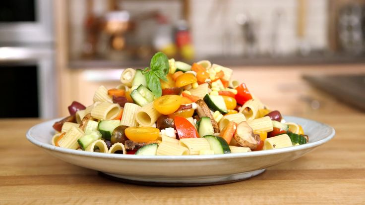 Filled with fresh mozzarella and sweet summer veggies, this is the pasta salad you've always craved.