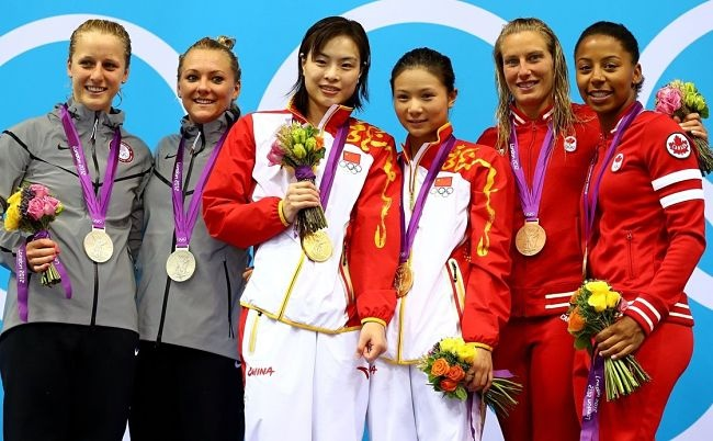 Emilie Heymans and Jennifer Abel (second and far right) show off their bronze medal
