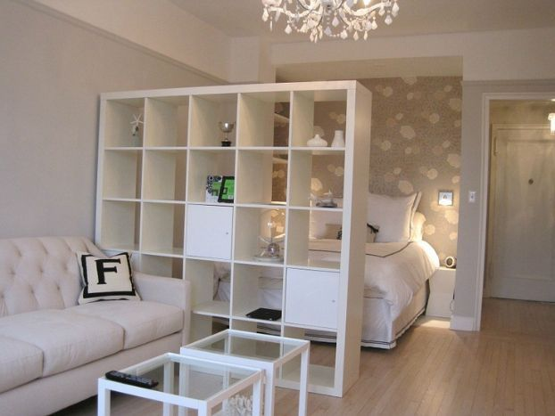 small studio apartment 9 ideas | Love this use of a giant bookshelf and neutral decor to make the most of the space!