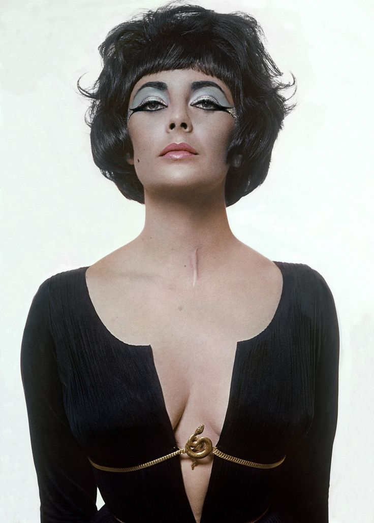 Liz Taylor - you can see her tracheotomy scar after a bout of pneumonia in 1961. Later she had the scar surgically removed.