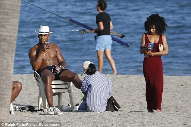 Life's a beach: Anthony Joshua appeared back to his usual self after the drama on Friday, as he continued to enjoy a family holiday in Marbella