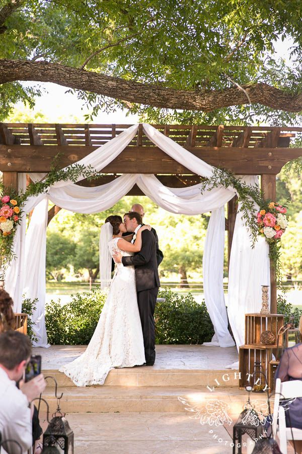 Ceremony Under The Pergola With Bright Summer Flowers