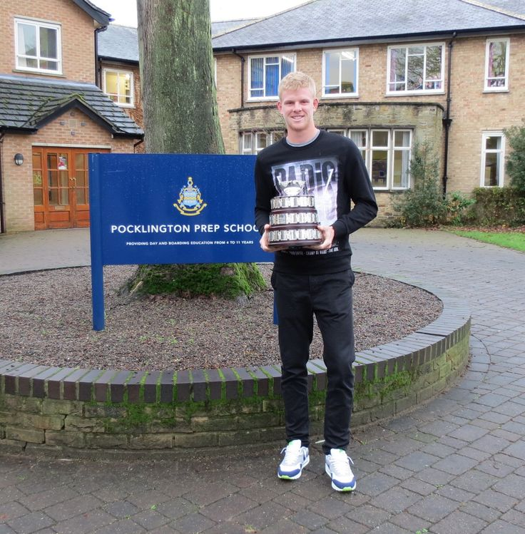 Tennis star Kyle Edmund took time out from celebrating his Davis Cup team triumph today to visit Pocklington School and Pocklington Prep School and show off a replica trophy.