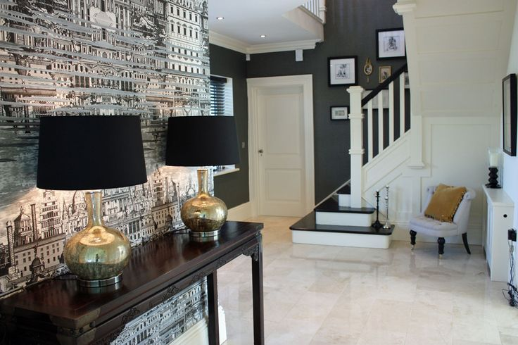 Modern hallway design with gold lamps. Designed by Missi Gray Interior design.