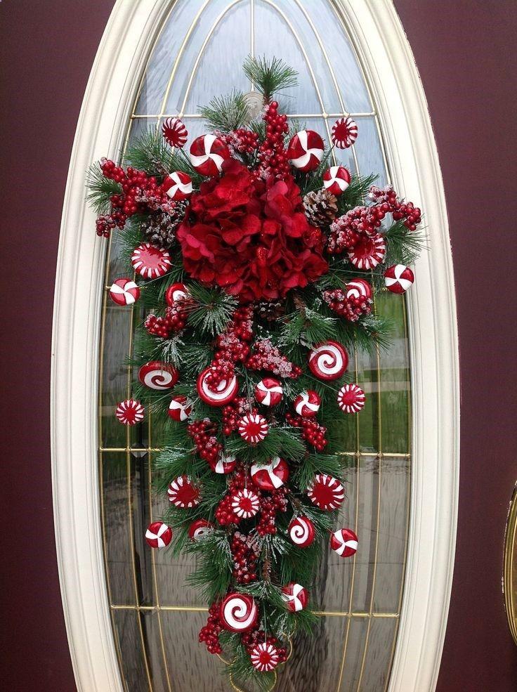 Christmas Wreath Winter Wreath Vertical Teardrop Door Swag Decor..Peppermint Candy. $89.00, via Etsy.
