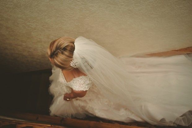 dreamy wedding photograph bride walking down stairs