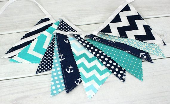 This adorable bunting is made with the cutest fabric! Aqua Blue, Navy Blue and Teal Blue Stripes, Chevron and Anchors make up this Fabric Bunting.