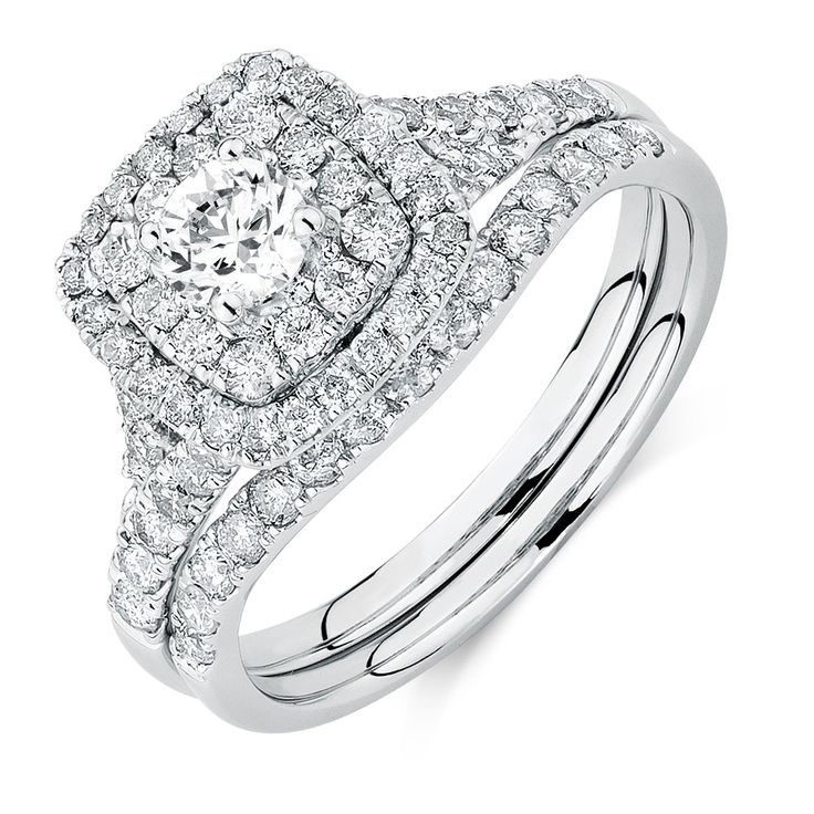 She will fall in love all over again with this beautiful 14ct white gold bridal set, showcasing a total 1.18 carats of diamonds. The central diamond on the engagement ring is framed by two sparkling halos, and the matching wedding band is moulded perfectly to sit beside it. This set will take her breath away.