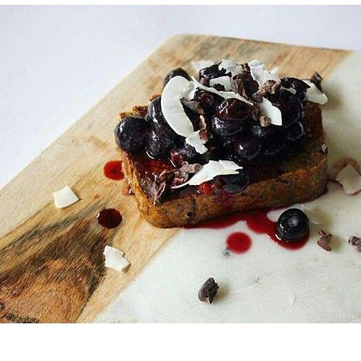 Another slice of @_natural nutrition_ 's homemade #glutenfree #vegan Pear, fig and walnut loaf made with @lydiateff brown teff. She's topped it off with smashed organic blueberries, @goodnessmebox coconut chips and @livingearth #raw cacao nibs.