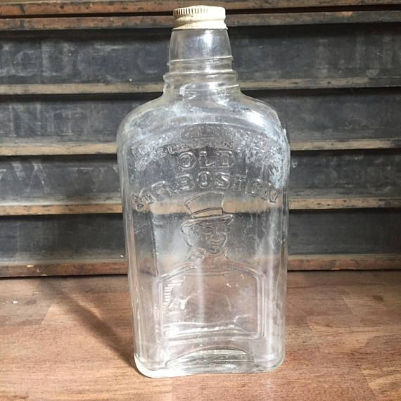 Check out this cool Old Mr. Boston liquor bottle. It has beautiful embossed images on the glass and has its original screw cap. The front of the bottle has Federal Law Forbids Sale or Reuse Of This Bottle embossed on it. Which dates the bottle to sometime during the prohibition