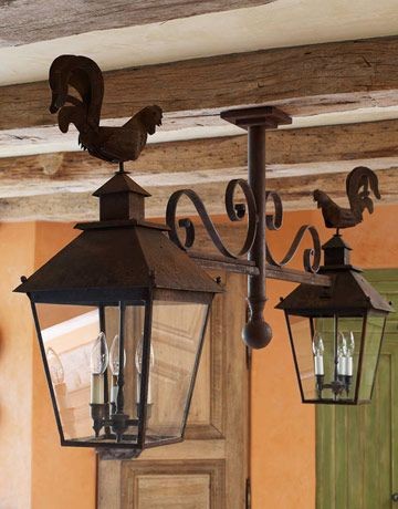 """DAMN...I was hoping i could buys this!! """"someone found a pair of rusty iron antique rooster lanterns and then designed the crosspiece to connect them."""""""