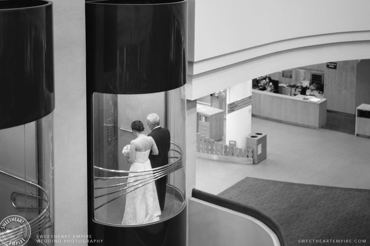Bride coming down elevator for her processional, at Toronto Reference Library  #sweetheartempirephotography