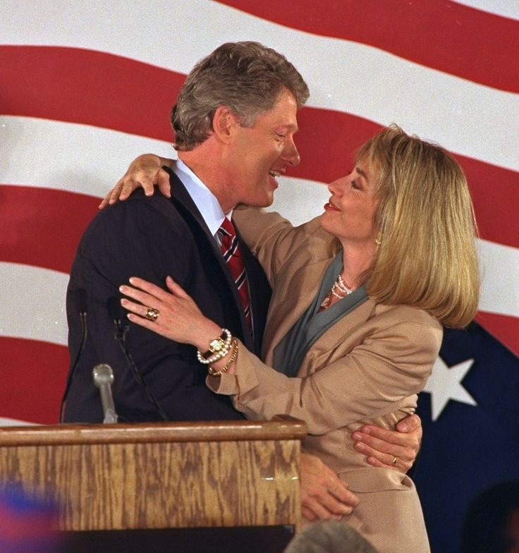 1992 ELECTION - Hillary Clinton, right, embraces her husband, Arkansas Gov. Bill Clinton, in Los Angeles Tuesday night after he secured enough delegates to capture the Democratic presidential nomination.