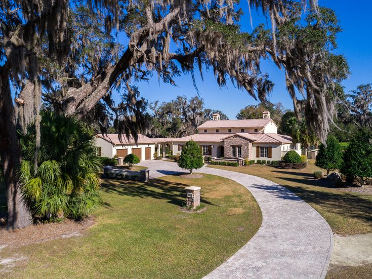 Captivating custom home located in gated community of Bel Lago in Ocala,FL. For Sale.