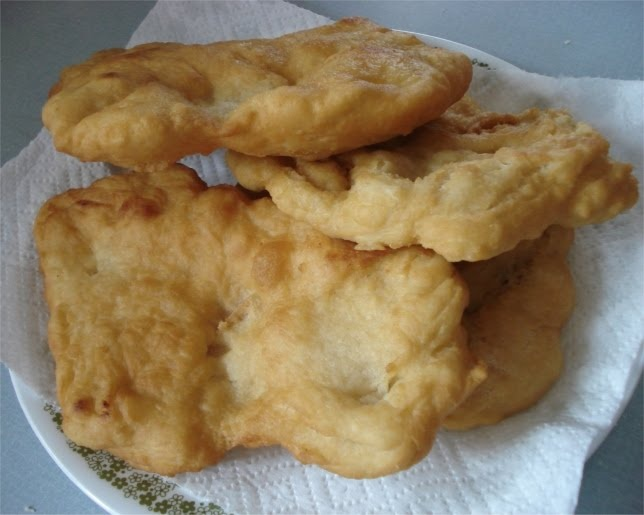 Fry Bread - TREK STYLE     4 cups flour  1 cup dry milk  2 tbsp baking powder  1 tsp salt  1 1/2 cups luke warm water    Mix dry ingredients together in one gallon zip lock bag and add water.  Knead for 2 or 3 minutes until smooth.  Make sure your bag remains tightly closed.  Pull off golf ball size or large pieces and pat out flat then fry in melted shortening.  Don't forget to make some yummy honey butter for a delicious treat.