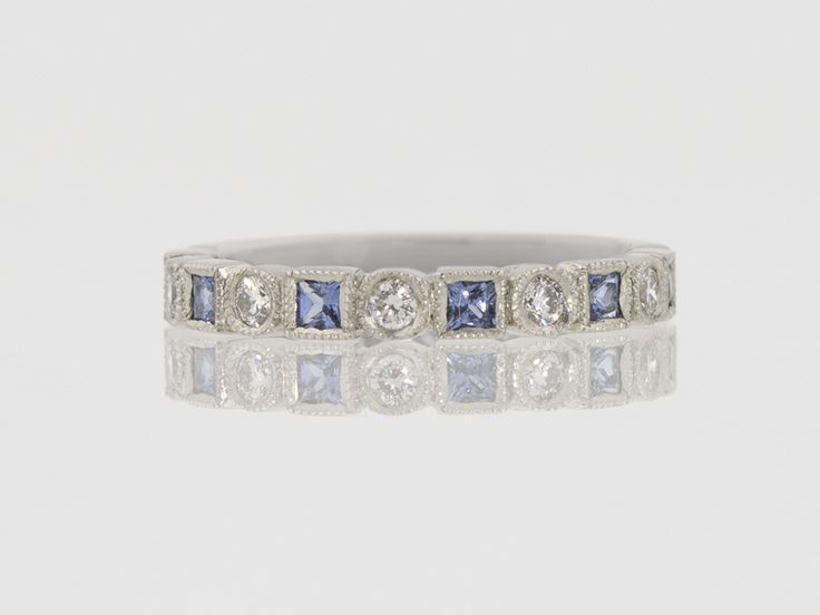 Platinum sapphire and diamond band.  Hand carved, Union Street Goldsmith, San Francisco.
