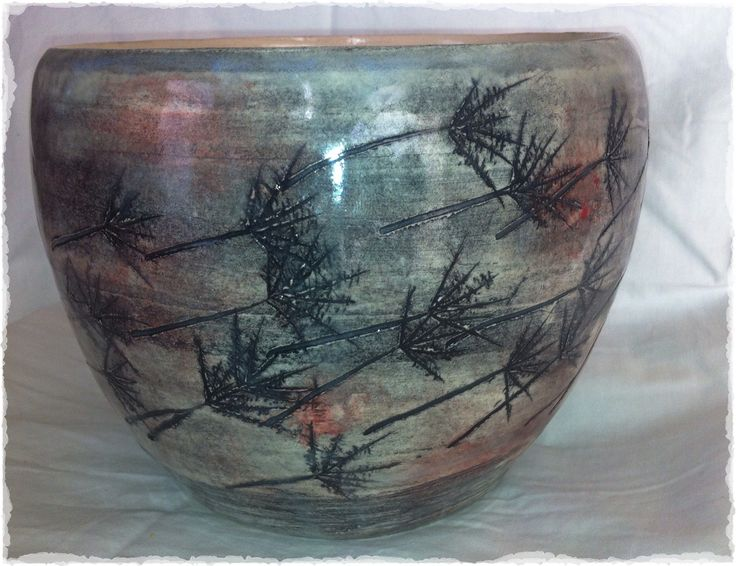 Nat H. Deep Hand thrown bowl with scratching and underglaze decoration. ^6 fire.