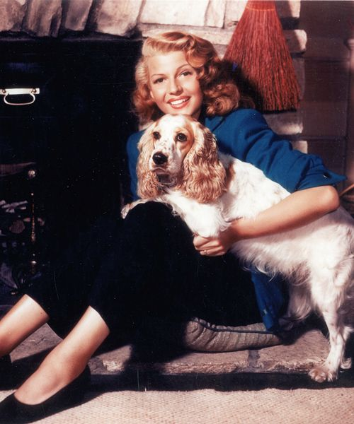 Rita Hayworth with her Cocker Spaniel Pookles.