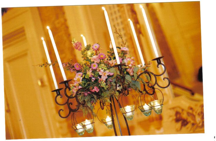 Candlelight adds a fairytale glow to the centerpieces at the Hotel Dupont.