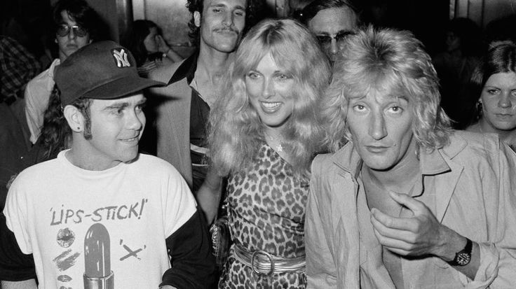 Elton John, left, Alana Hamilton, wife of actor George Hamilton, and rock singer Rod Stewart (her future husband) arrive at Studio 54