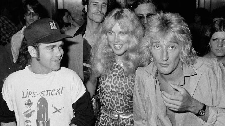Elton John, left, Alana Hamilton, wife of actor George Hamilton, and rock singer Rod Stewart (her future husband) arrive at Studio 54