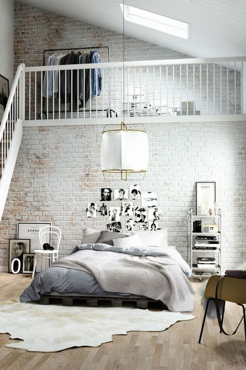 Heart the white loft brick, don't like the animal skin rug, heart the light fixture. Rad bed too.