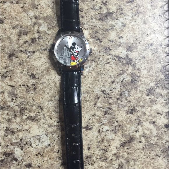 Mickey watch Worn a couple times. Bought at Disney World genuine leather band embossed. Unique design. Jewelry