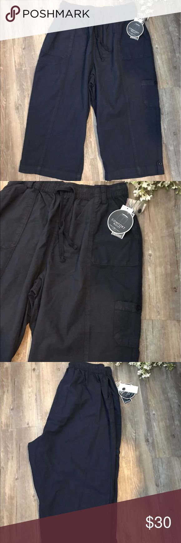 NWT Karen Scott Comfort Waist Capris Cropped Pants New with tags. Karen Scott Comfort Waist Plus Size Navy Blue Women's Capris Cropped Pants. The unique nature of this clothing is that it has been garment-dyed. This soft, well-worn look has slight color shading as part of its desired characteristics. 100% Cotton. Pet free/smoke free home. Ships same/next day. Karen Scott Pants Capris