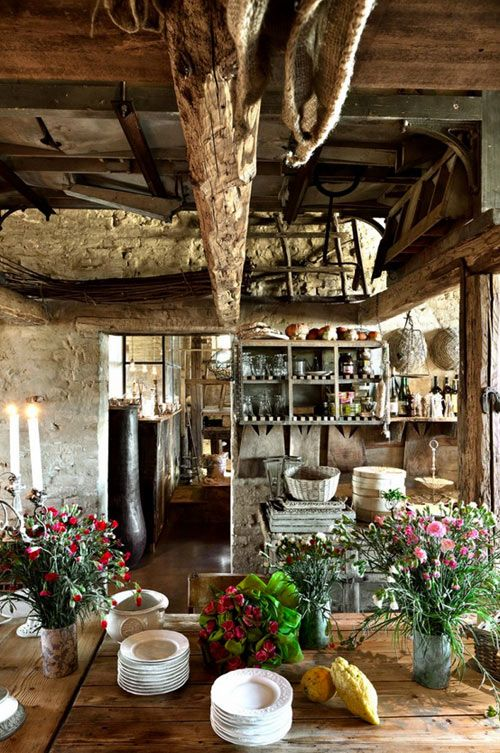 Italian Rustic Kitchen: this is exactly how country people in their country homes make use of space. Most things are stored or hung from the ceilings/rafters. It's unused space!! Very authentic.