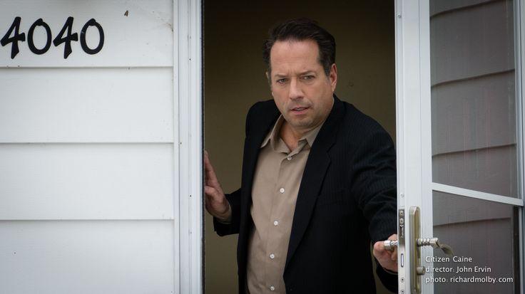Lou Phillips (Scott Carson) makes an unpleasant discovery outside his home in Saint Paul, MN. www.ervinflix.com
