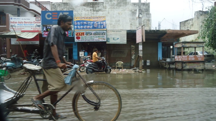 People wade through the flood waters on a  Meerut street. Picture by  CJ Roy