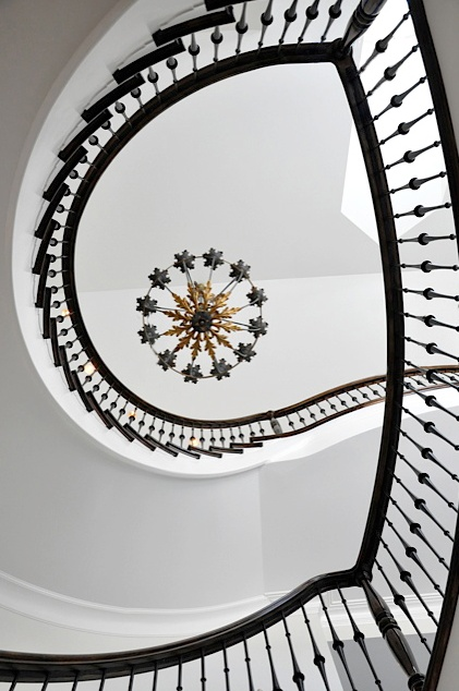 Love, love, love The swirling shape of this staircase is stunning. The owner could've decorated the area a lot more but it would be very much like gilding a lily. It looks fabulous like this and is beautifully photographed.  Triciax