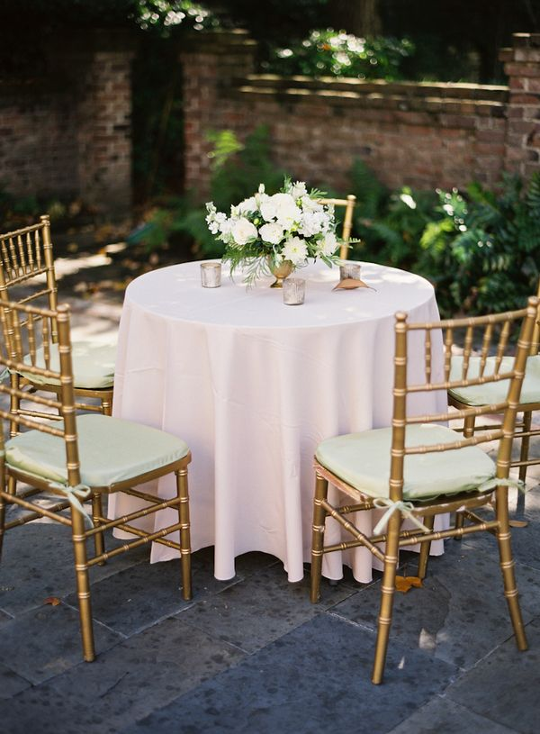 gold chiavari chairs with ivory chair pads