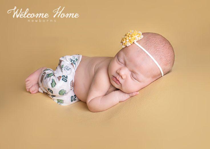 Welcome home newborns an eau claire wi newborn photographer newborn football fan