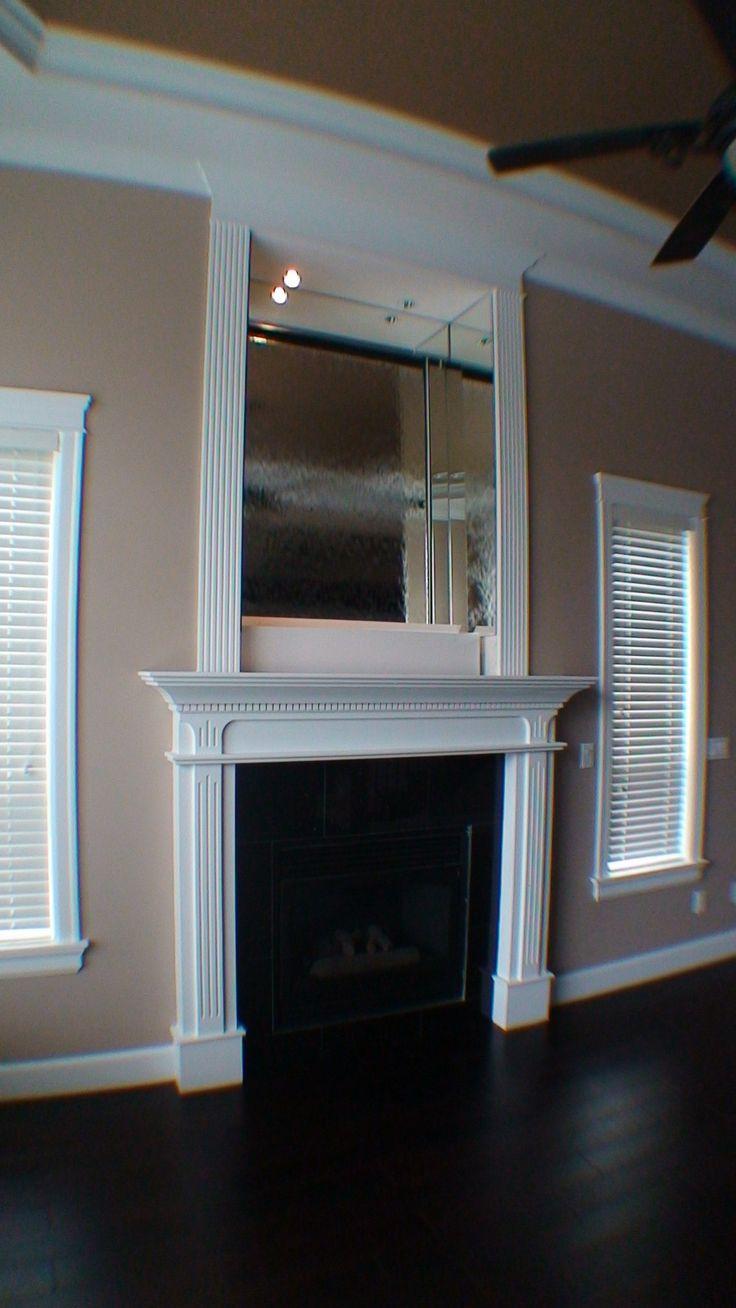 custom mirror glass waterfall above fireplace http://waterfallnow.com https://waterfalldecor.com
