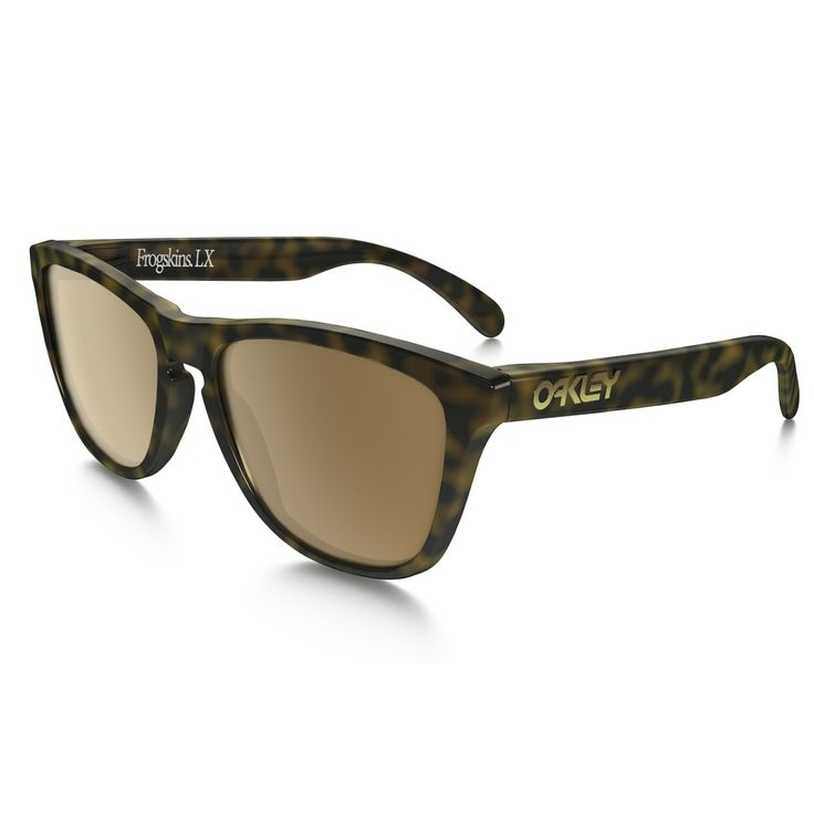 Oakley's  Frogskins Sunglasses (Dark Brown Tortoise): Oakley Frogskins OO2043-06 (Dark Brown Tortoise) Acetate Frame  Dark Brown Lens Polarized Lens  All lenses block 100 per cent of UVA/UVB/UVC rays and blue light up to 400 nm. Oakley sunglasses come with a one year warranty.