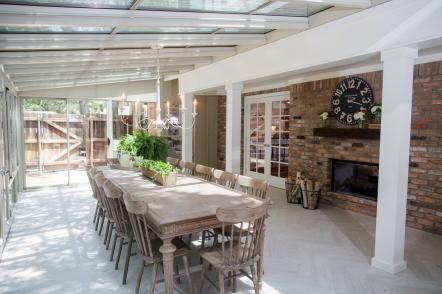 The formal dining area is now located in this open space which had previously been a sun porch adjacent to the living room.