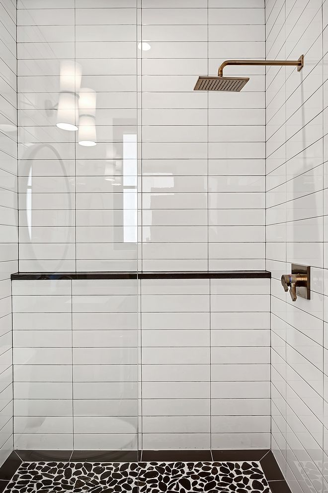 Shower Tile 4x16 White Subway Tile In A Horizontal Stack Pattern And River Rock For Shower Base