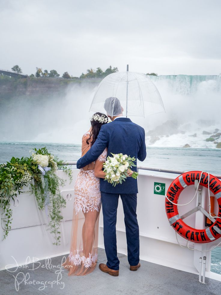 Gorgeous photo of bride and groom gazing at Niagara Falls. Stunning wedding photography at one