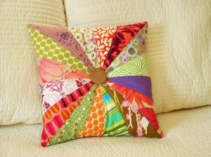 quilted pillow. love the button in the middle