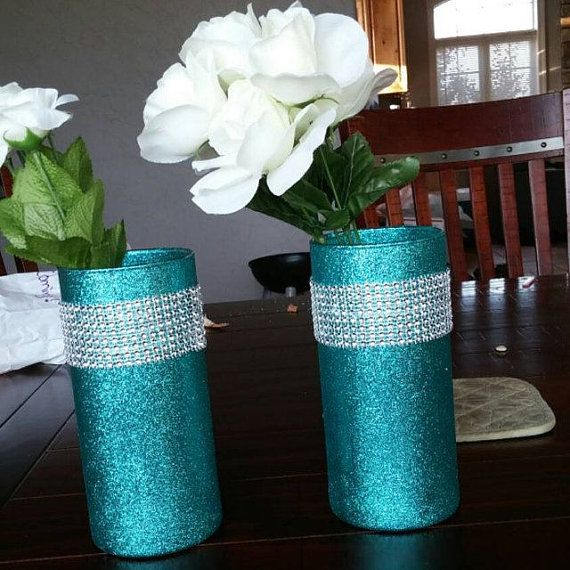 5 Beautiful Glittering Glass Cylinder Vases. The vases in this listing are decorated in glitter, and sealed to reduce glitter shedding, then embellished with silver or gold bling mesh that imitates rhinestones, starting about an inch from the top of the glass. If you want the exact design in the main photo, choose teal/turquoise/aqua glitter, and then choose silver bling.  Specifics/Measurements: 7.5 vase height (approx. 3.25 opening).  BULK DISCOUNT PRICING IS AVAILABLE FOR QUANTITIES OF 20…