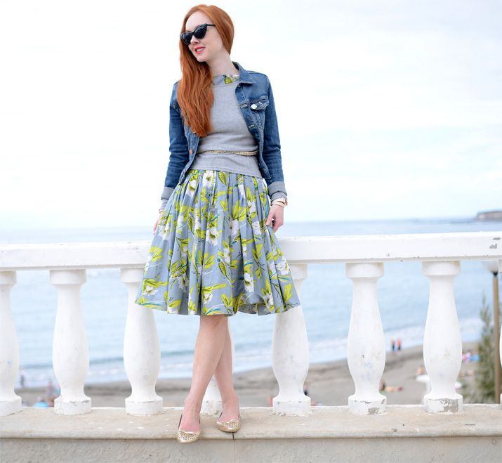 floral sundress with denim jacket, grey sweater and gold ballet flats