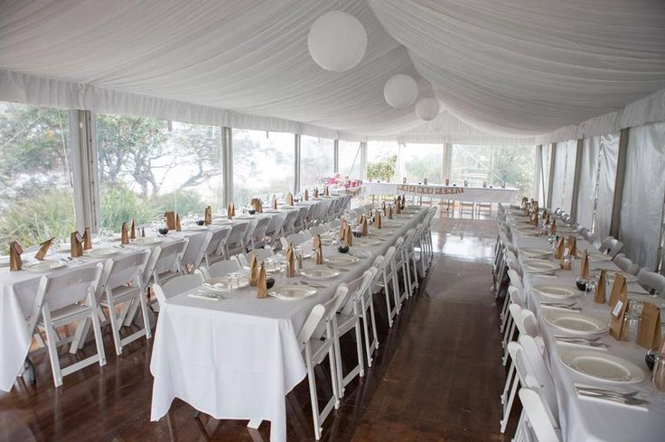 silk lining, rice paper lanterns, 6m marquee structure, integrated timber flooring, trestle tables, white padded folding chairs, clear walls, south coast weddings, south coast party hire