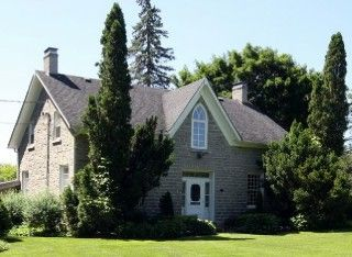 Step back in time as you approach the elegantly landscaped grounds of an historic stone home, built circa 1855. Finely-crafted & set amongst trimmed hedges and seasonally blooming perennial gardens, is tucked away on a private 6.5 acres secluded from neighbours yet only minutes from charming and picturesque downtown Campbellford.