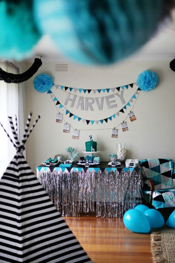 Hues of blue make this geometric  party theme a creative way to celebrate your little boy. This first birthday party theme is brought to life with a dessert table and a play tent for the party guests to enjoy.